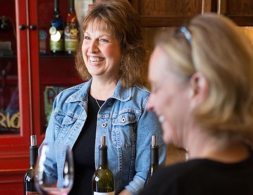 Trio Vintners owner Karen LaBonte smiles in her tasting room.