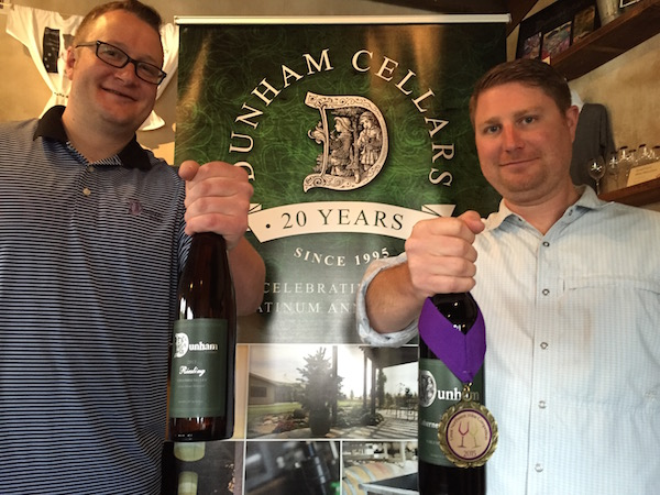 Dunham Cellars general manager John Blair, left, and winemaker Daniel Wampfler display their two wines that made the cut to be poured at the Washington State Wine Commission's tent during the 2015 U.S. Open Golf Championship at Chambers Bay.