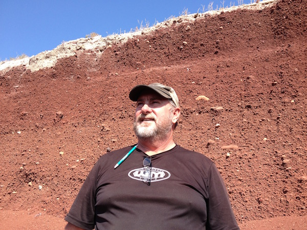 Dale Jeffers, vineyard manager for Winemakers LLC, marvels at the cinder soils of Sawtooth Vineyard.