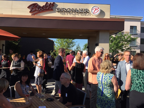 Members of the Washington state wine industry gather to celebrate the opening of Budd's Broiler, a new steakhouse brand of Antthony's Restaurants.