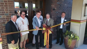 Anthony's Restaurands founder Budd Gould cuts the ribbon with Benton County Commissioner Jerome Delvin, Richland Mayor Pro Tem Phillip Lemley, WSU viticulture and enology director Thomas Henick-Kling, and assistant chancellor at WSU Tri-Cities Ken Fincher.