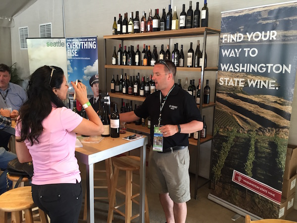 Chris Stone, VP of marketing and communications for the Washington State Wine Commission, leads East Coast golf author Elisha Goudet through a wine tasting Thursday during the 2015 U.S. Open at Chambers Bay Golf Course in University Place, Wash.