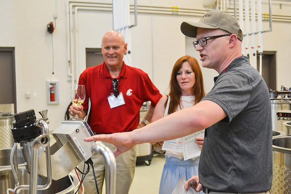 Jim Harbertson, wine chemist for Washington State University, leads a tour of the Ste. Michelle Wine Estates Wine Science Center in Richland, Wash.