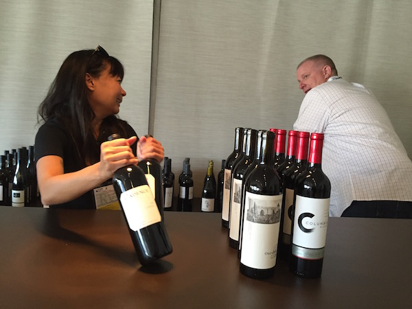 Michaela Baltasar, left, and Rob Andersen of Washington State Wine Commission stock Thursday's wine for their tent during the 2015 U.S. Open at Chambers Bay Golf Course in University Place, Wash.