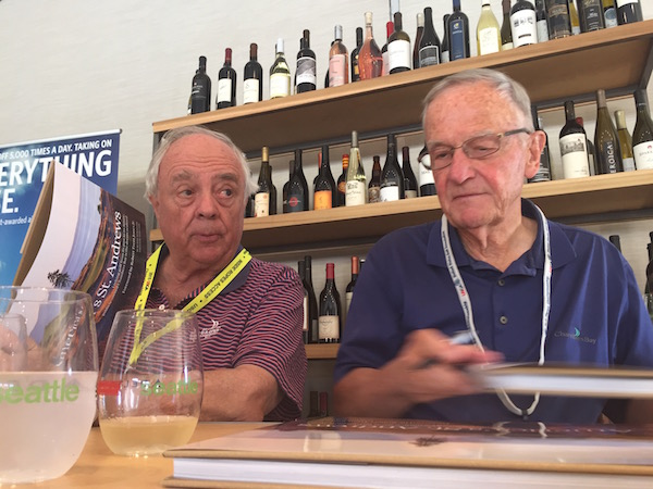 Course architect Robert Trent Jones, Jr., left, and golf writer Blaine Newnham sign copies of 'America's St. Andrews' at the Washington State Wine Commission tent on Wednesday, June, 17, 2015.