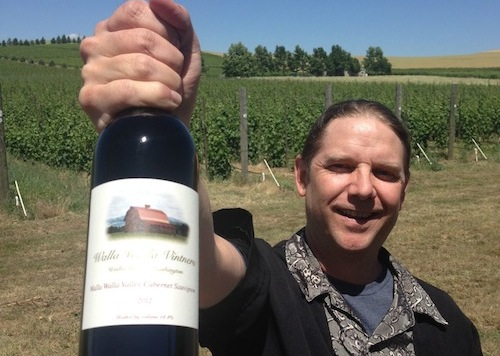 Winemaker William vonMetzger holds up a bottle of his award winning Walla Walla Vintners 2012 Cabernet Sauvignon, the top wine of the 2015 Walla Walla Valley Wine Competition. (Photo by Andy Perdue/Great Northwest Wine)