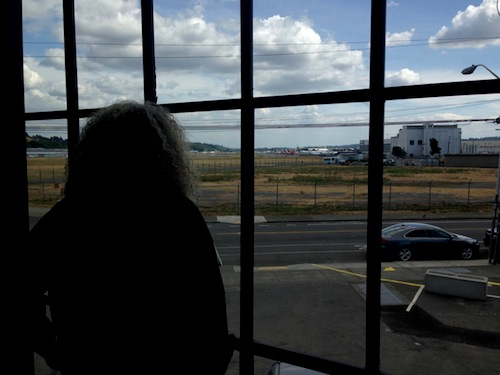 Charles Smith looks out over Boeing Field from his new winery and tasting room in Seattle's Georgetown neighborhood.