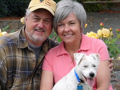 John and Judi Stuart, shown here with their terrier, Fuzz, continue to operate Abbey Road Farm as a B&B, but Judi no longer makes her acclaimed goat cheese.