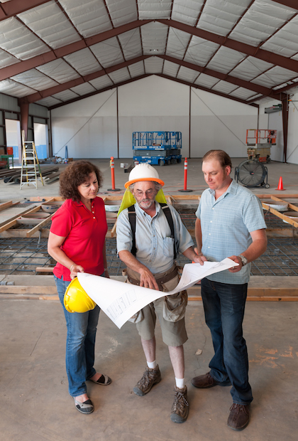 Naumes, Inc., plans to open its new Naumes Crush and Fermentation facility in Medford, Ore., on Aug. 1. Laura Naumes, goes over plans with project manager Kyle White, center, and winemaker Chris Graves.