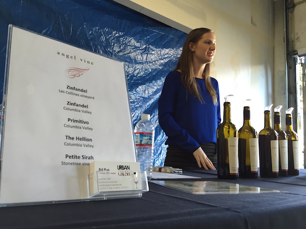 Ed Fus and Laureen O'Brien's daughter, Morgan, helps pour during a trade tasting at Urban Crush Winery in Portland.