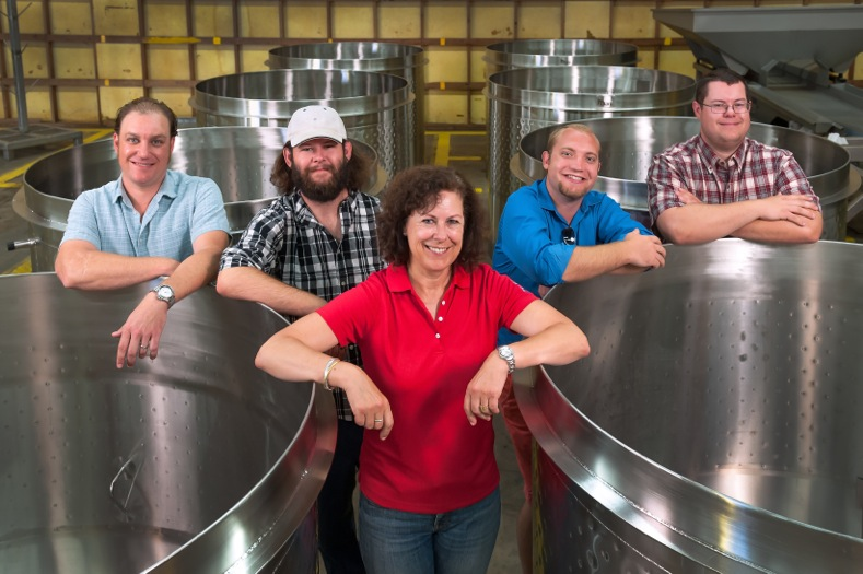 Laura Naumes, CEO of Naumes Crush and Fermentation, is flanked by, left to right, winemaker Chris Graves, Joe Naumes, Elliott Anderson and Sean Naumes. (Photo courtesy of Naumes, Inc.)
