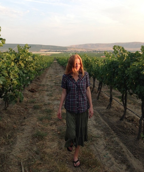 Sarah Goedhart walks through a vineyard at Hedges Family Estate on Red Mountain