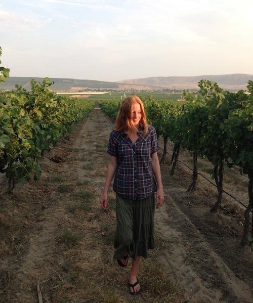 Sarah Goedhart walks through a vineyard at Hedges Family Estate on Red Mountain