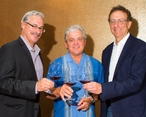 Panther Creek Cellars winemaker Tony Rynders, Panther Creek Cellars founding winemaker Ken Wright, and Sam Bronfman, co-founder and managing partner of Bacchus Capital Management, raise a toast on July 13 in Portland during a trade luncheon at Imperial Hotel.