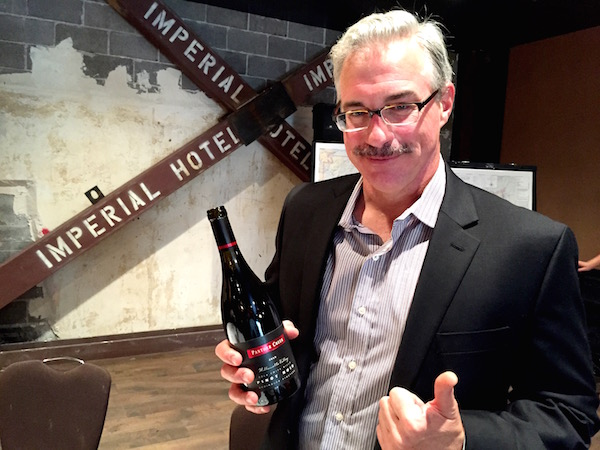 Tony Rynders has fun touting one of the 2013 single-vineyard wines he  created for Panther Creek Cellars.