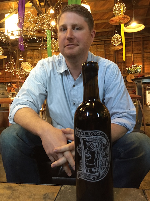 Daniel Wampfler, with a bottle of the Dunham Cellars 2009 Founders Blend, has been the head winemaker at Dunham Cellars in Walla Walla since 2008.