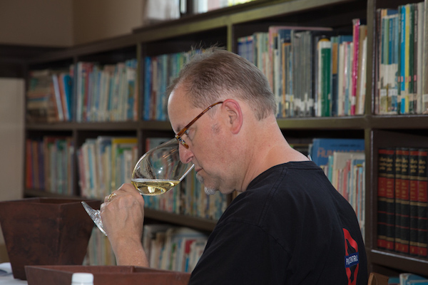 Doug Frost, a Master of Wine and a Master Sommelier, judges the 2015 Oregon Wine Experience competition in Jacksonville. (Photo by Colony One Studio/Courtesy of Oregon Wine Experience)