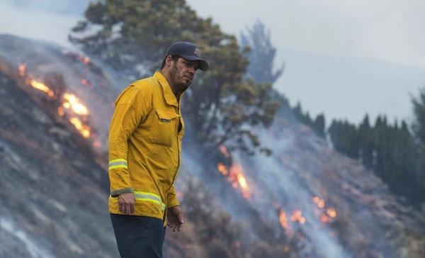 Firefighters battle blazes in Lake Chelan, Washington.