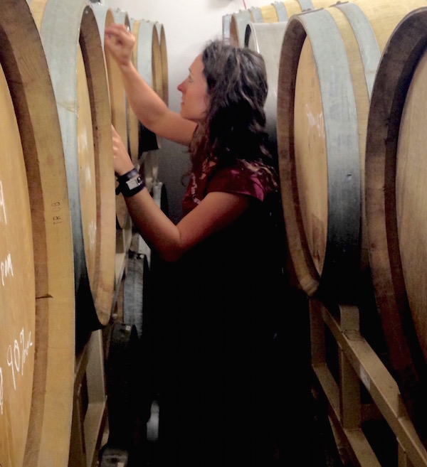 Meredith Bell, co-winemaker/co-owner of Statera Cellars, charts the progress of her Chardonnay barrels at Omera Cellars in Newberg, Ore.