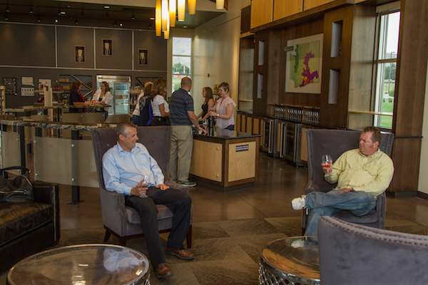 A group of visitors relaxes at the bar in the Walter Clore Wine and Culinary Center tasting room in Prosser, Wash. (Photo by Donna Tudor/courtesy of the Clore Center)