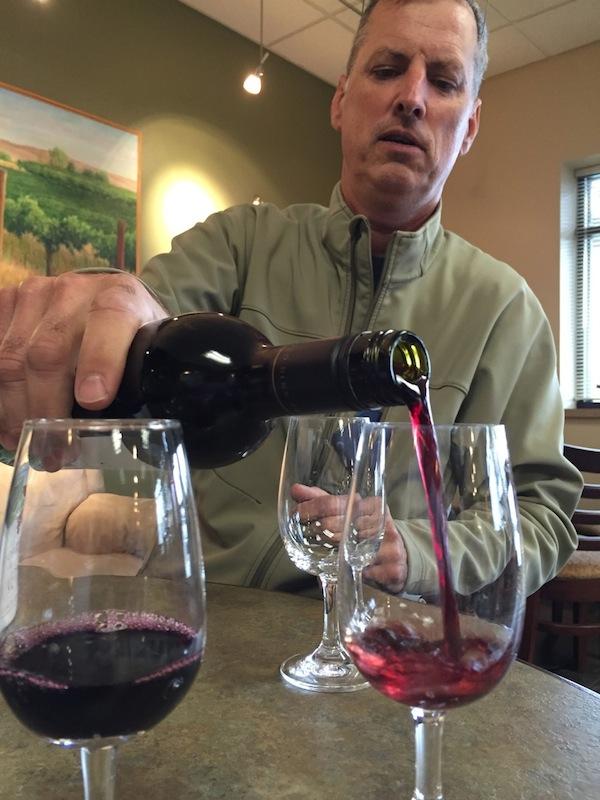 Co Dinn Cellars owner pours Cabernet Sauvignon.