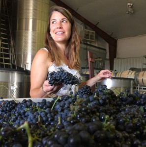 Meredith Smith looks through Petite Sirah grapes at Sawtooth Estate Winery in Nampa, Idaho.