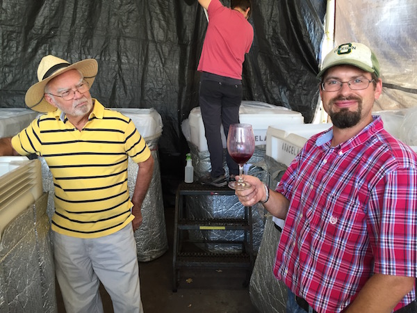 Founding winemaker Earl Jones and head winemaker Andrew Wenzl taste through fermentations from the 2015 vintage. (Photo by Eric Degerman/Great Northwest Wine)