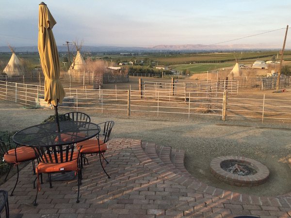 Cherry Wood Bed Breakfast and Barn in Zillah, Wash., includes a fire pit and patio with views of the corral, the Yakima Valley and Mount Adams.