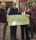 The 2015 Barrel Full of Money campaign generated $23,723 for the Blue Mountain Action Council's Walla Walla Food Bank. Making the presentation, left to right, are Duane Wollmuth, Walla Walla Valley Wine Alliance; Scott Peters, Columbia REA and Blue Mountain Action Council members Kathy Covey and Jeff Mathias,