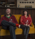 Brooks winemaker Chris Williams and winery director Janie Brooks Hueck relax in the new tasting room at Brooks Wines in Amity, Ore. (Photo by Andrea Johnson Photography/courtesy of Brooks Wines)