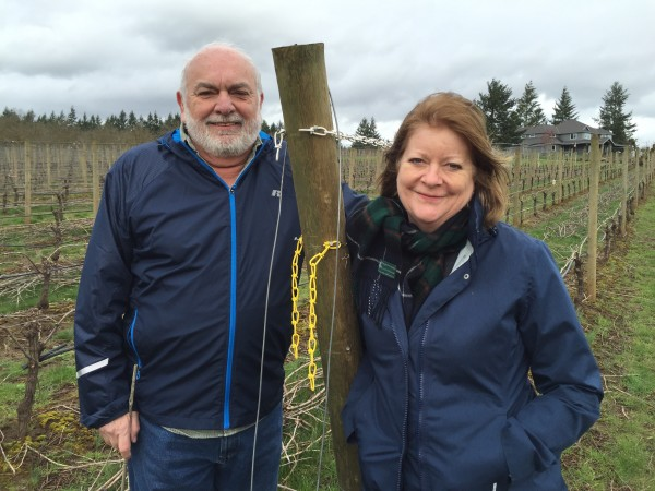 Nick and Sheila Nicholas of Anam Cara Cellars in Newberg, Ore., stand in front of their 6-acre block of vineyards in the Chehalem Mountains American Viticultural Area. They recently announced the sale of Nicholas Estate Vineyard to Celia and Ken Austin, III, of Rain Dance Vineyards in Newberg.