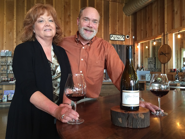 Ken Austin, III, and Celia Austin pour their Rain Dance Vineyards Pinot Noir at their Rain Dance Marketplace along Bell Road in Newberg, Ore. (Photo by Eric Degerman/Great Northwest Wine)