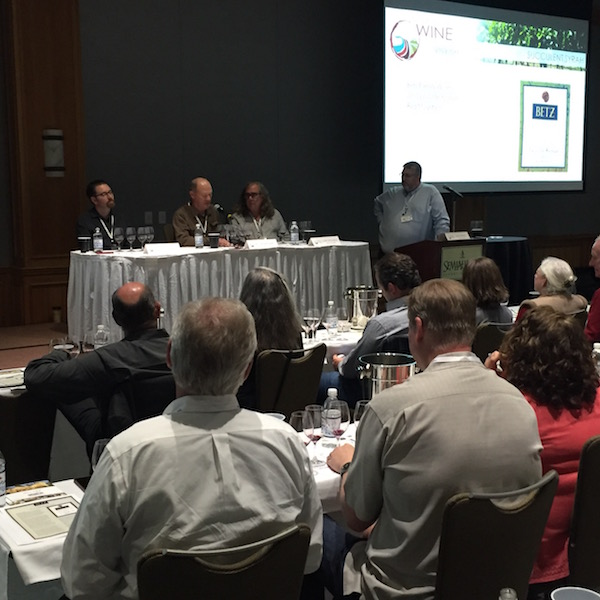 Louis Skinner, left, assistant winemaker at Betz Family Winery, listens to famed viticulturalist Dick Boushey, center, and founding winemaker Chris Upchurch of DeLille Cellars during a Red Mountain panel discussion Saturday, April 16, 2016 at the inaugural Northwest Wine Encounter at Semiahmoo Resort and Spa in Blaine, Wash.