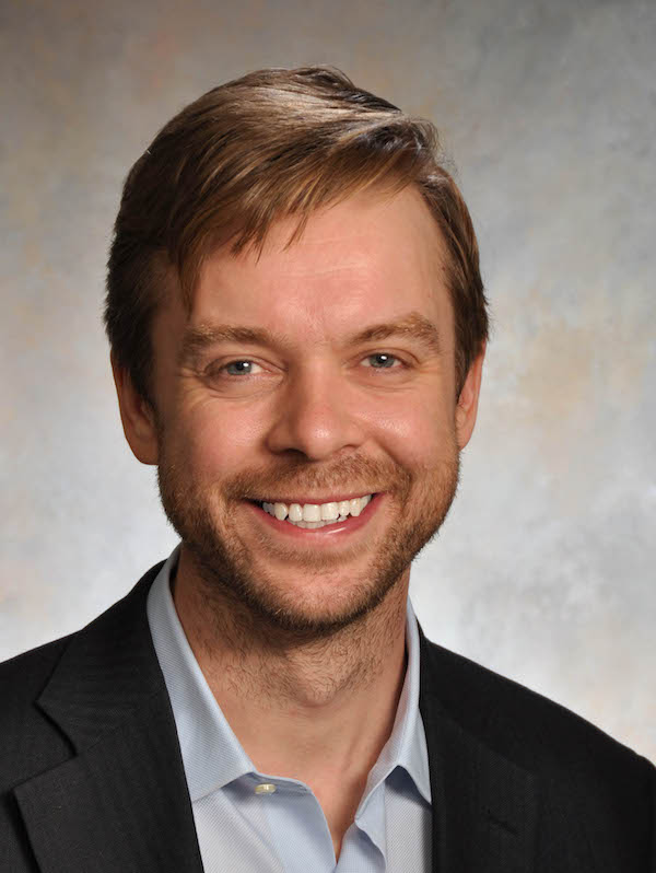 """Jack Gilbert, an associate professor in the Department of Ecology and Evolution at University of Chicago, presents his lecture """"Managing Expectations: The Microbiome in Agriculture"""" on May 5, 2016 at Linfield College in McMinnville, Ore. (Photo courtesy of Linfield College)"""