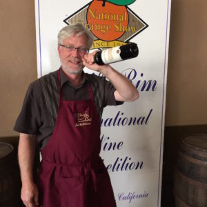 Texan winemaker Jon McPherson hams it up with his South Coast Winery 2014 Mourvedre after the wine was awaded best of show at the 2016 Pacific Rim International Wine Competition.