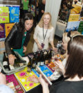 Representatives of Lake Chelan Wine Valley pour for patrons at Taste Washington 2016 in Seattle.