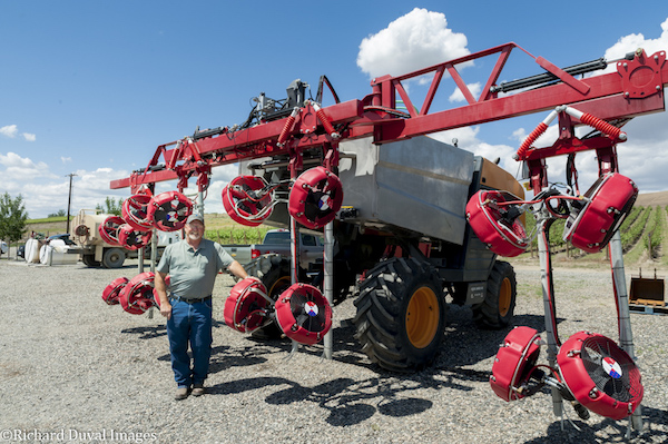 Marshall Edwards, vineyard operations manager Shaw Vineyards and Northwest Vineyard Management, stands next to the four-station mechanical sprayer he uses at Quintessence Vineyards on Red Mountain.