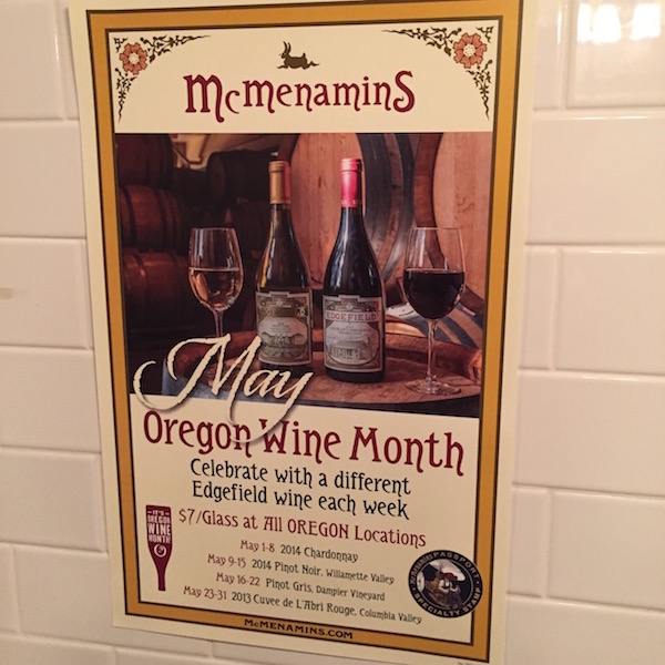 This poster promoting Oregon Wine Month hangs in the men's washroom at Gearhart Golf Links, which is owned Oregon native Tim Boyle. He brought on longtime friends, the McMenamin brothers, to head up the dining and lodging at Hotel Gearhart. (Photo by Eric Degerman/Great Northwest Wine)
