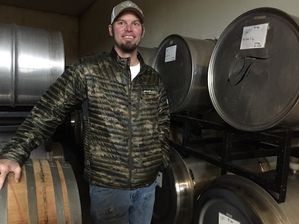 The cellar of Rob Folin and Folin Cellars features oak barrels and stainless steel drums.