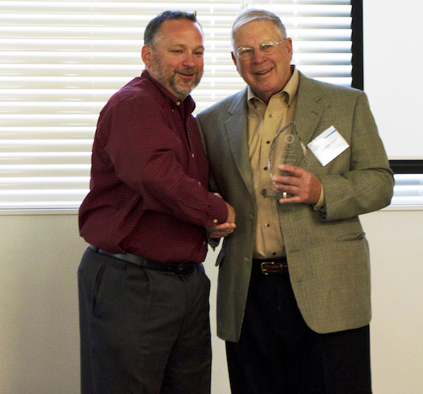 Anthony Anton, left, president of the Washington Restaurant Association, presents Budd Gould, founder/ president of Anthony's Restaurants, with the award for Full Service Operator of the Year.