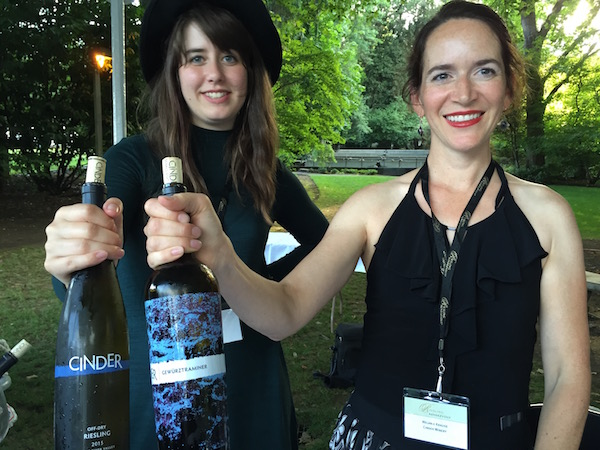 Cinder Wines enologist Hailey Alexander, left, and Cinder owner/winemaker Melanie Krause pour wines from Idaho's Snake River Valley at the grand tasting of Riesling Rendezvous on Sunday, July 17, 2016 in Woodinville, Wash. (Photo by Eric Degerman/Great Northwest Wine)