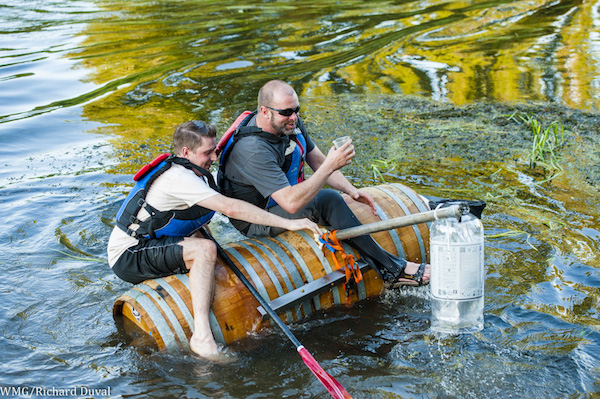 John Patterson of Patterson Cellars uses wine barrels as a flotation device for the kayak portion of the Woodinville Winemaker, Brewer and Distiller Triathlon