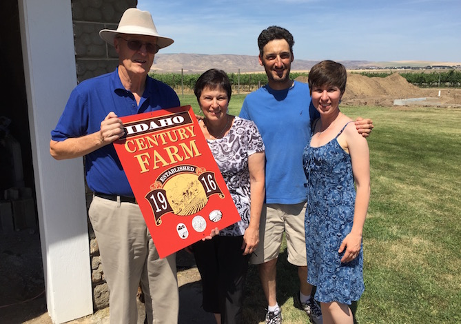 Earl Bennett, trustee for the Idaho Historical Society, presents an Idaho Century Farm plaque to Mary McQuary, Karl Umiker and McQuary's daughter, Coco Umiker of Umiker Vineyard and Clearwater Canyon Cellars.