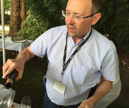 Nicolas Quille, head winemaker of Pacific Rim Winemakers in West Richland, Wash., pours at the grand tasting of Riesling Rendezvous on Sunday, July 17, 2016 in Woodinville, Wash. (Photo by Eric Degerman/Great Northwest Wine)