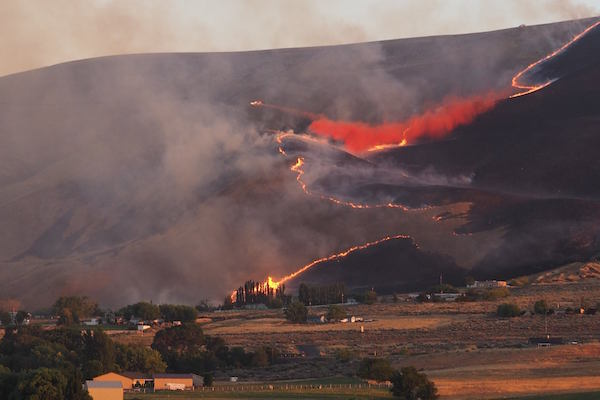 Firefighters drop retardant on flames that threaten wineries and vineyards along the northern flanks of the Horse Heaven Hills in the lower Yakima Valley near Benton City, Wash., on Thursday, July 14. (Photo courtesy of Larry Oates)