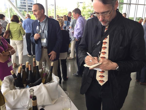 British author Stuart Pigott, one of the world's foremost experts in Riesling, writes notes while examples of Riesling from Idaho offered Monday, July 18, 2016 at the Idaho Wine Commission table during the Riesling Rendezvous's Showcase Walk Around Tasting at the Seattle Art Museum's Olympic Sculpture Park. Pigott wrote 'The Best White Wine on Earth: The Riesling Story' in 2014. (Photo by Eric Degerman/Great Northwest Wine)