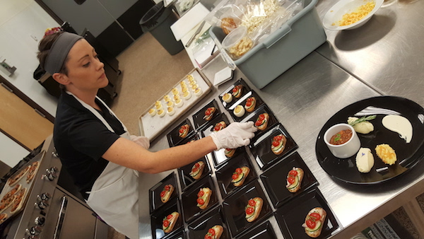 Ethos Group chef Janna Noble prepares a variety of menu items available daily at the Walter Clore Wine and Culinary Center in Prosser.