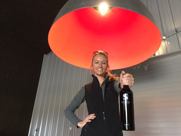 Sydney Nederend flips on the eclectic dome light this month inside the tasting room for Scoria Vineyards and Winery in Caldwell, Idaho.