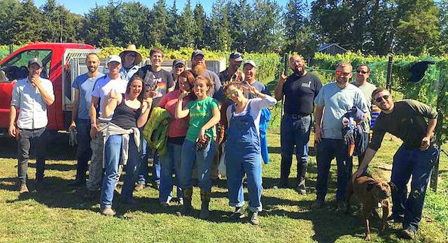 Walla Walla Community College viticulture and enology students ham it up at Red Boar Vineyard, the birthplace of their award-winning 2016 Muscat Ottonel. (Photo by Greg Schnorr/Courtesy of Red Boar Vineyard)