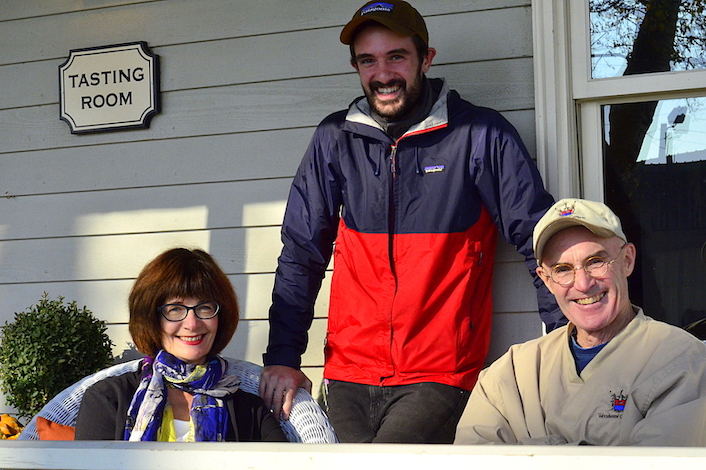 Sager Small, center, stands on the porch at Woodward Canyon Winery in Lowden, Wash., with his parents, Darcey Fugman-Small and founding winemaker Rick Small.